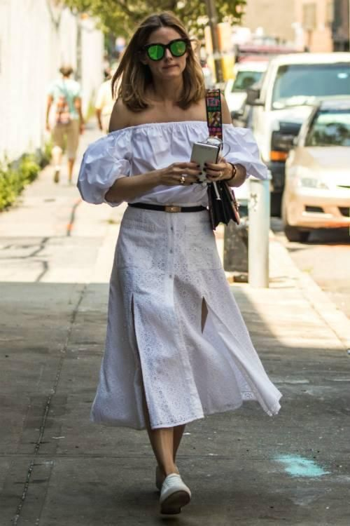 Olivia Palermo wearing Tularosa Indira Poppy Eyelet Skirt, Kenneth Cole Kam Pride Sneakers, Hermes Kelly Belt, Le Specs Air Heart Sunglasses and Etro Rainbow Bag