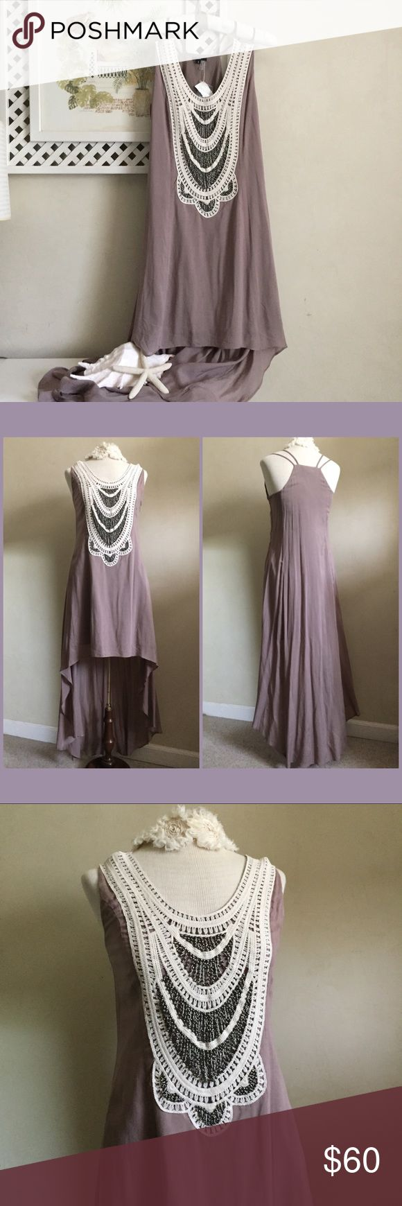 Stunning Beaded Tunic Dress Absolutely beautiful beaded dress with high-low hemline in mauve color. Brand new with tag. Paid $60 for it and would like to get as much of return here after Poshmark commission. So I don't have much wiggle room for negotiation. Fora Dresses High Low