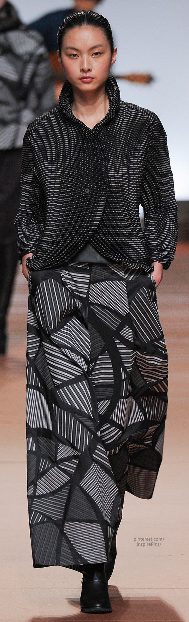 Issey Miyake Fall 2014 RTW   this belongs in fantasy fashion, i like the print on the skirt and the geometric shaping of the jacket