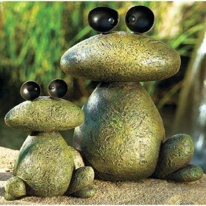 Garden frogs out of rocks paint and glue.