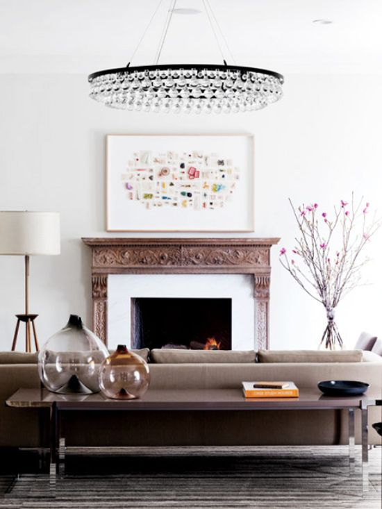 Living room with circular crystal chandelier on Thou Swell @thouswellblog