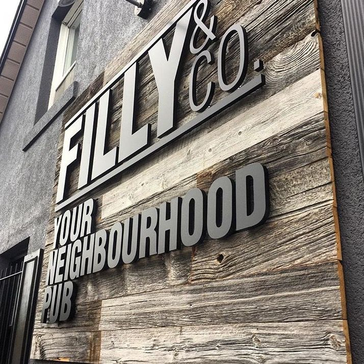 "Custom barn board sign for ""Filly & Co"" in Aurora"