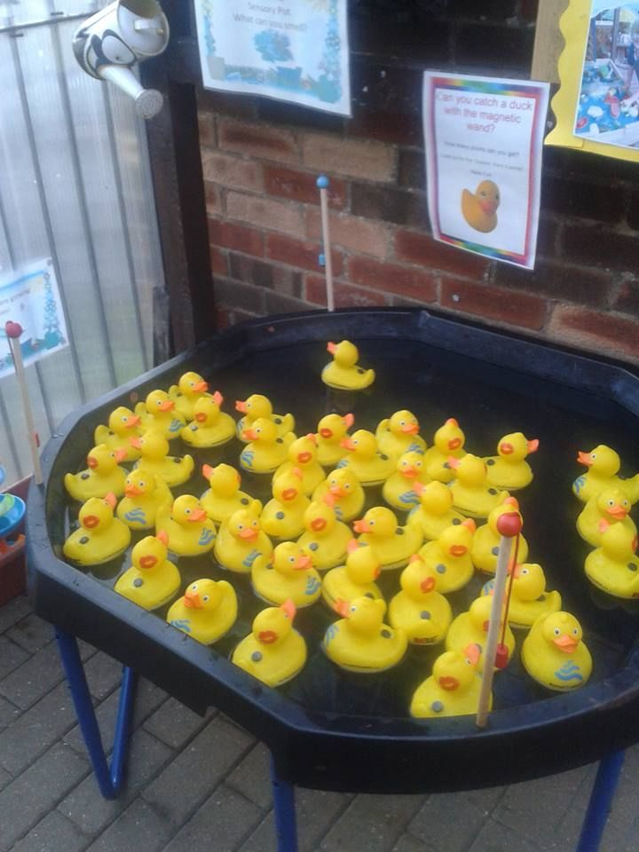 Sensory fishing ducks magnetic bin: created with rubber duckies and glued magnets + a fishing pole with a magnet attached to the string- by Yvette Bray ≈≈
