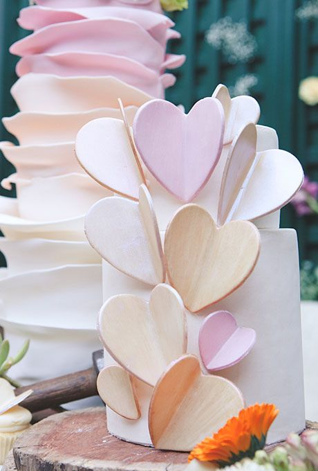 Brides.com: Heart-Themed Wedding Cakes. Large Pastel Hearts Wedding Cake. A spring wedding calls for a soft color palette. This cake by Blissfully Sweet has whimsical hearts that create a stunning visual effect.  Browse cake ideas for a spring wedding.