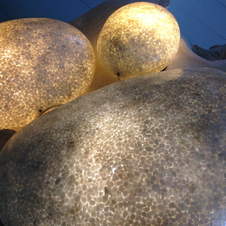 Luxurious pebbles floor and tables lights by Chora Art Home Design.