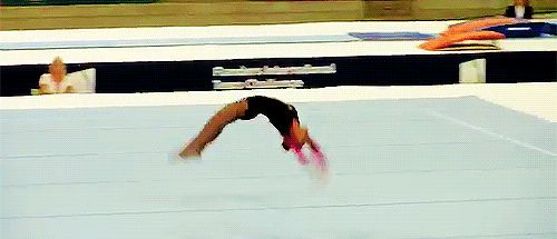 (gif of Rebeca Andrade's 1.5 twisting double back)