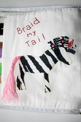 A quiet book page where you braid the zebra's tail, rather than a little girl's hair. I like it. id do a unicorn