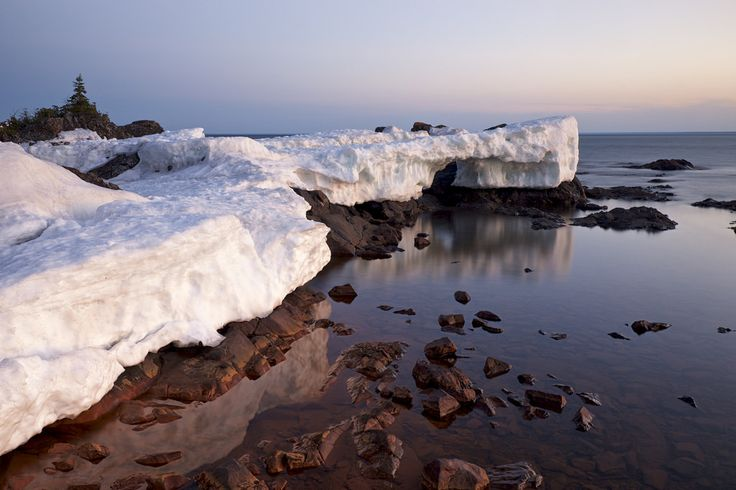 "twurdemann posted a photo:  Last of the Lake Superior fast ice at Sawpit Bay- -about 80 km north of Sault Ste. Marie Ontario.  Fast ice is an extensive unbroken sheet of ice that is ""fastened"" to the shoreline or shoals; the ice forms from freezing temperatures (air and water), waves, drift ice, and snowfall."