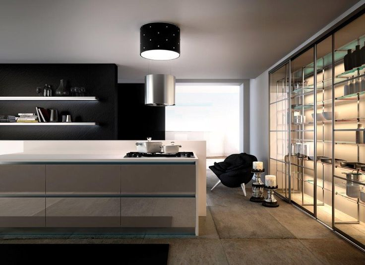 Sophisticated and stylish, Chic is the princess of the F-light range. The body of the hood is in stainless steel with the light coverings in black glass embellished with miniscule gem drops creating a simple but effective contrast.