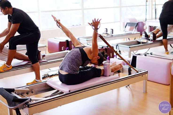 Yuhan works her upper body strength and shoulder flexibility in the Rowing Series on the Reformer. Love! www.thepilatesflow.com.sg https://www.facebook.com/ThePilatesFlow