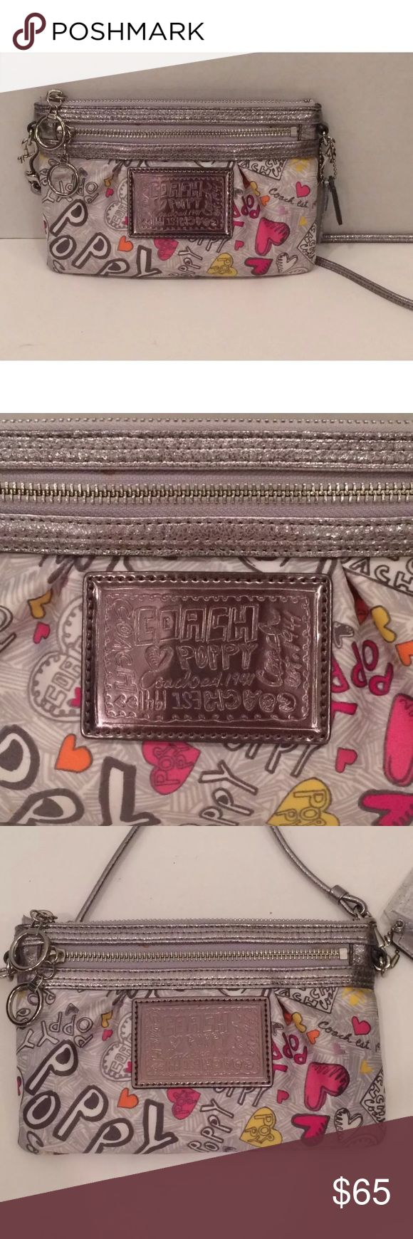 Coach poppy heart graffiti small crossbody purse You are looking at a Coach silver poppy heart graffiti crossbody purse. It's new without the tags and in excellent condition. Coach Bags Crossbody Bags