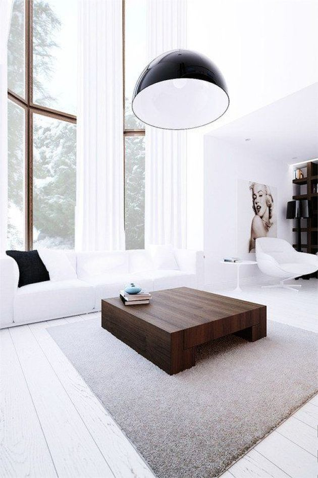 White Minimalist Living Room With Double Height Windows And A White Sofa Minimalist Living Room Design Minimalist Living Room Minimalist Living #white #minimalist #living #room