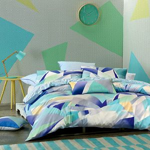 An edgy, abstract print using pale pastels and vibrant blues, Stratosphere is complemented by a triangular print reverse in pale blue and a trim of blue piping. The clean, contemporary lines create a stylish design that will add dramatic flair to the bedroom. The euro pillowcase features the small reverse print and the cushion covers the abstract design. The quilt cover has press stud closure.