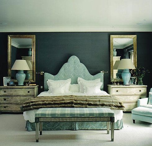 Great idea to hang oversized mirrors above each nightable. They frame the headboard beautifully.