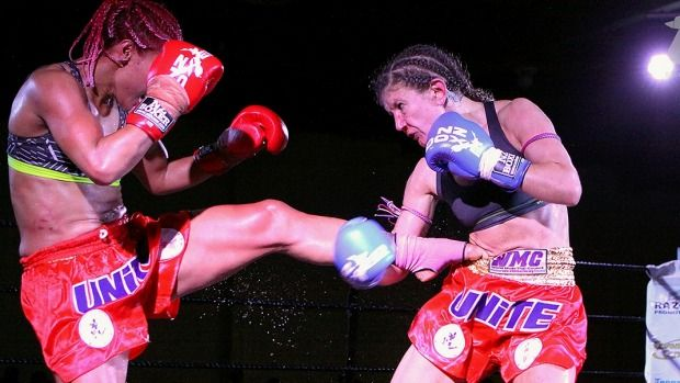 Campaign to end violence against women spreads the message to muaythai fans.