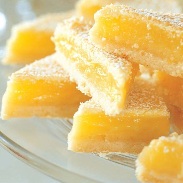 Lemon Bars - Barefoot Contessa.... crust is amazing ... bars are super lemony ... very tart and tangy, but delicious!!
