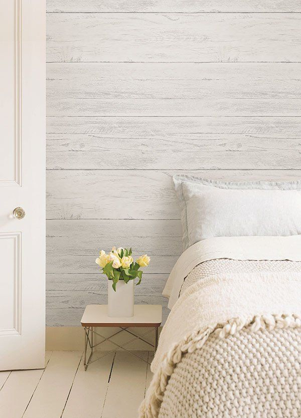 If you've always dreamt of having a white wood feature wall, this is the perfect wallpaper for you. The shiplap design has an aged appearance with subtle distre