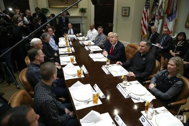 U.S. President Donald Trump speaks while meeting with executives and union representatives from the Harley Davidson company at the White…