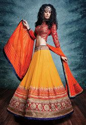 Enjoy the wedding season wearing this Faux Satin Georgette Jacquard Lehenga in Ochre. The lining of this Semi-stitched attire is Satin. The hemline and waistline is intricately embroidered with Resham, Golden Zari and Sequins in Abstract motif. As shown, an embroidered Art Silk and Faux Georgette Choli in Red and a Net Dupatta in Saffron. You can customize the Waist size from 28 to 40 inches and the Hip size from 28 to 42 inches on selection of stitching services. The length is 44 inches…