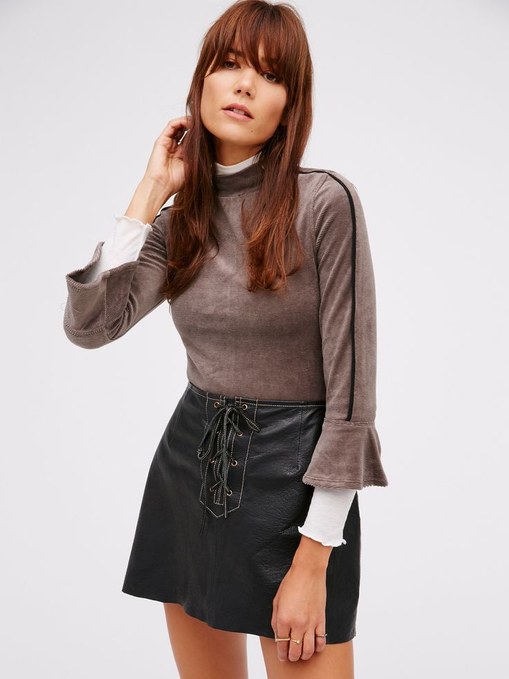 Zoe Tee   Cute velvet tee with a touch of femme. Features a high neckline, flared sleeve cuffs and subtle contrast details.