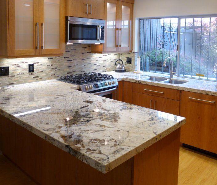 Alpine White Granite  hate the cabinet color love the