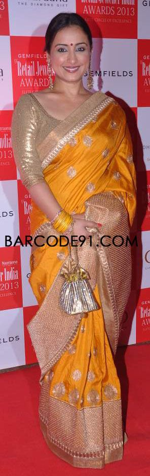 http://www.barcode91.com/ Divya Dutta in yellow saree with shimmer blouse  at 9th Annual Gem Fields & Nazaranna Retail Jeweller Awards 2013.