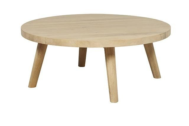 This beautiful coffee table is made of solid oak and is the perfect Scandinavian inspired piece for any living room setting. It's solidity is clear in it's round thick top which perched upon it's tapered legs, creates a negative space to make your living room feel light and airy yet functional.