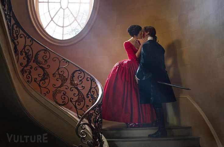 Official Claire Jamie S2 Vulture Two new official photos from the second season of Outlander were released by Vulture's Instagram account today.  The first shows Jamie and Claire kissing on the stairs with Claire in her red dress.  No doubt they are probably on their way to Versailles.