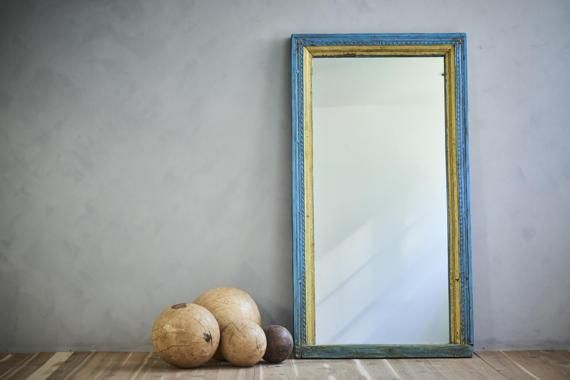This large floor mirror, made from a reclaimed architectural wood frame, will be the perfect anchor to your Moroccan space. As an accent for a stairway landing, a grand bathroom piece, a salon station mirror, or used in a retail setting, the rich, stunning colors of this perfect full length mirror will be sure to wow.  - Handmade with history to create a new family heirloom - Materials discovered in Rajasthan - Vintage frame, hand restored and brought new life - Materials: wood, mirror…