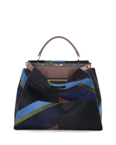 """Fendi """"Peekaboo"""" bag in dyed calf hair (France) and calfskin leather. Tote handle with rings; adjustable flat shoulder strap. Framed top with turn-lock clasp. 12""""H x 16""""W x 6""""D. Inside, two compartmen"""