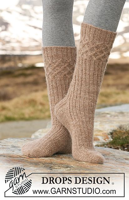 "(knee socks with cables at the top) Ravelry: 115-34 Socks with cables and rib in ""Alpaca"" pattern by DROPS design"