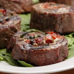Flank Steak Pinwheels with sun-dried tomatoes and Boursin cheese.