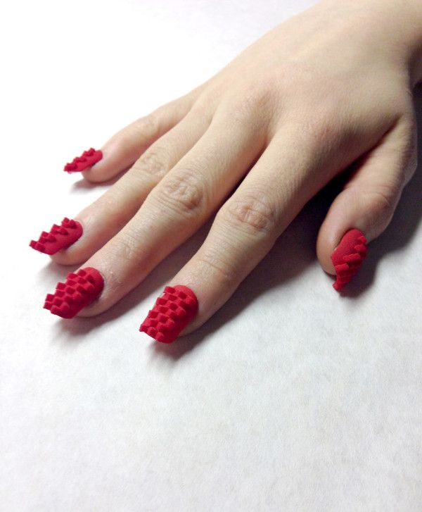 3D printed nails by Sarah C. Awad and Dhemerae Ford, aka TheLaserGirls. Completely understandable application for this technology. Maybe subtlety will come later. #Feb2014