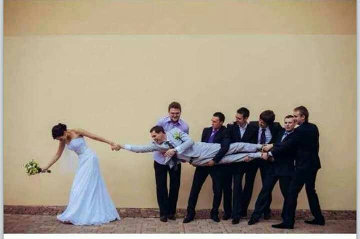 Fun groomsmen picture with husband & wife