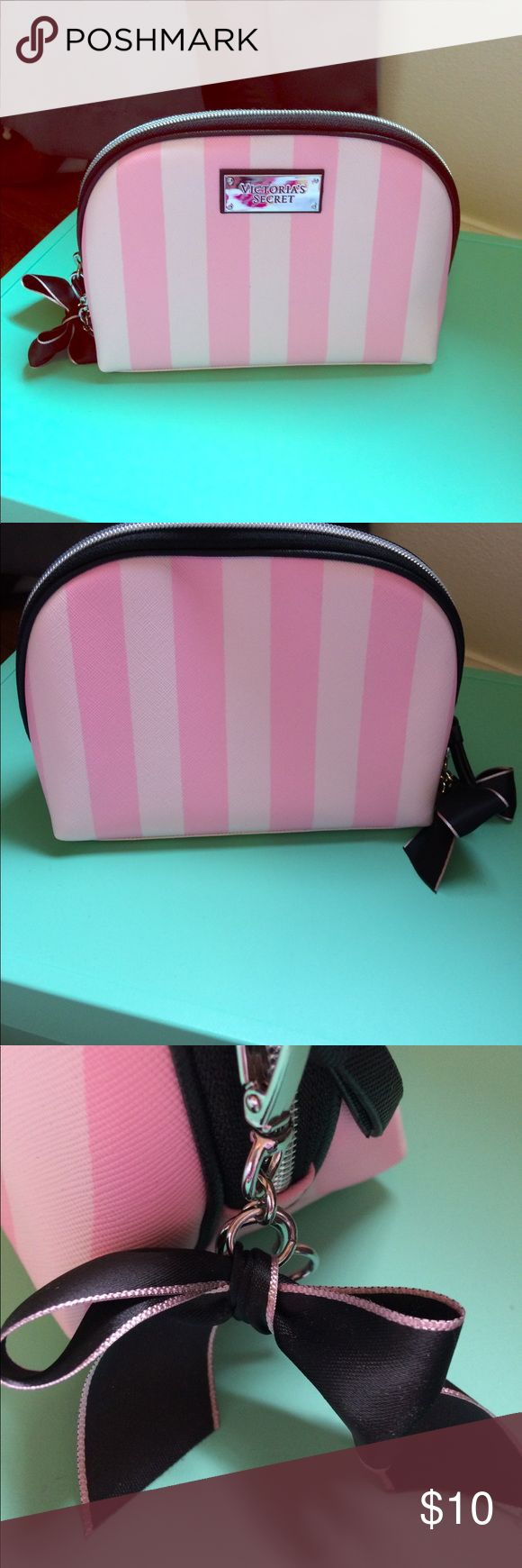 Victoria Secret Small Cosmetic Bag Victoria Secret Small Cosmetic Bag  Pink stripes with bow and heart ❤️ keychain  7in across x 5in Tall Great Condition Victoria's Secret Bags Cosmetic Bags & Cases