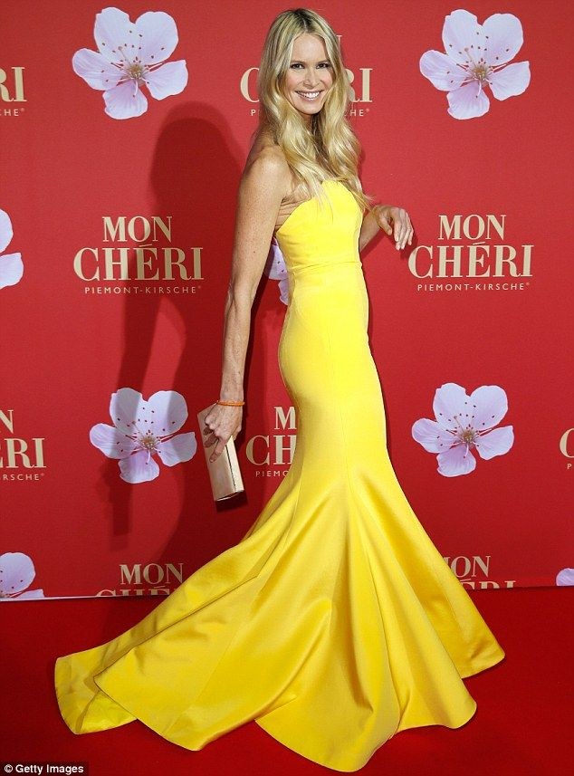 Summer brights: Elle Macpherson lightens up a winter evening in a stunning yellow mermaid dress as the Barbara Tag celebration in Munich