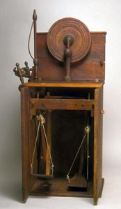 Spinning wheel in a cabinet