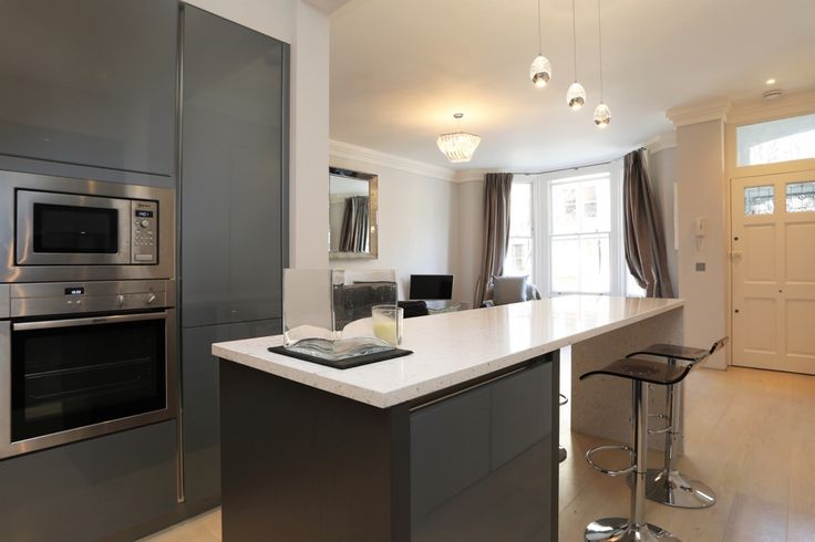 Grey gloss kitchen and kitchen island in Silver Grey metallic design glass finish.
