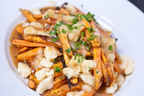 Variation of the Québécois classic Poutine. Learn how to make poutine with this sweet potato poutine recipe.
