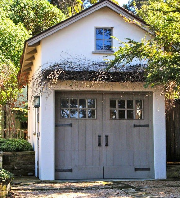 Door stain color. Vines, pergola over door. Strap hinges. Make end wall faux doors?