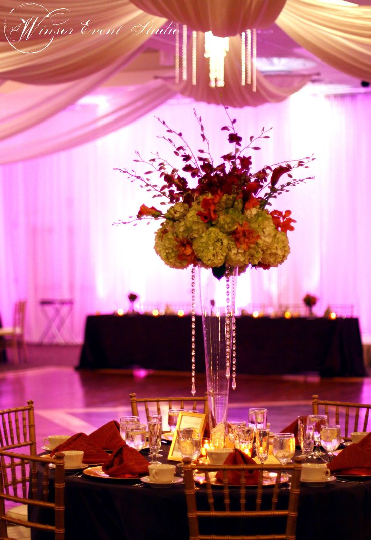 101 best centre table images on pinterest floral arrangements tall centerpieces of pilsner vases topped with clusters of green hydrangea orange mini calla lilies reviewsmspy