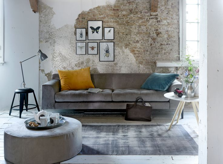 Industrial room with sofa, metal stool as a side table, large coffee table, teapot and mugs and wall posters of various insects | Photographer Dennis Brandsma, Sjoerd Eickmans | Styling Fietje Bruijn, Kim van Rossenberg | vtwonen catalog autumn 2015 | #vtwonencollectie