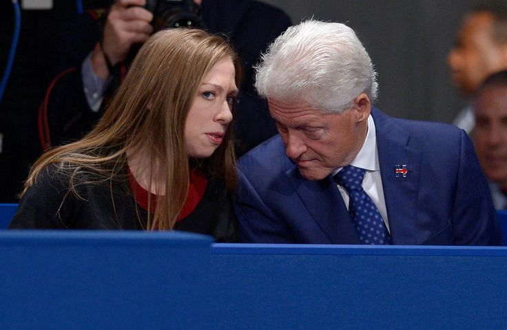 . Chelsea Clinton, daughter of Hillary Clinton, talks to former President Bill Clinton during the second presidential debate between Republican presidential nominee Donald Trump and Democratic presidential nominee Hillary Clinton at Washington University in St. Louis, Sunday, Oct. 9, 2016. (Saul Loeb/Pool via AP)