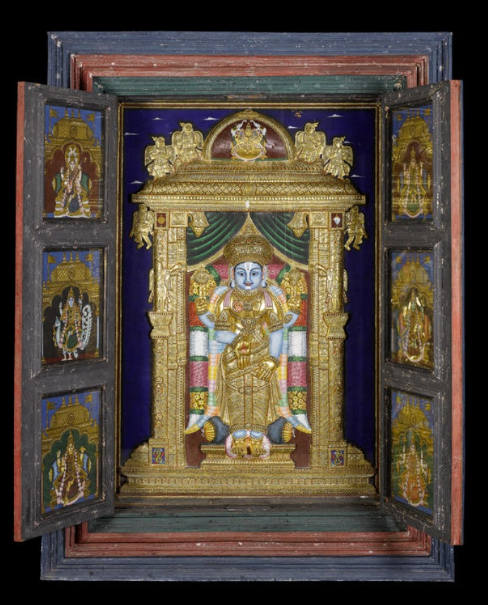 "A large mid-19th century hanging temple cabinet, the interior depicting Vishnu within an ornate alcove in relief, Tanjore, South India gouache and gold on board, the interior of the doors with six panels each depicting other Hindu deities, all enclosed within a painted wood cabinet, the exterior of the doors depicting a further four deities, gouache on wood within recessed panels, 169cm wide x 50cm deep x 228cm high, (66.5"" wide x 19.5"" deep x 89.5"" high)"