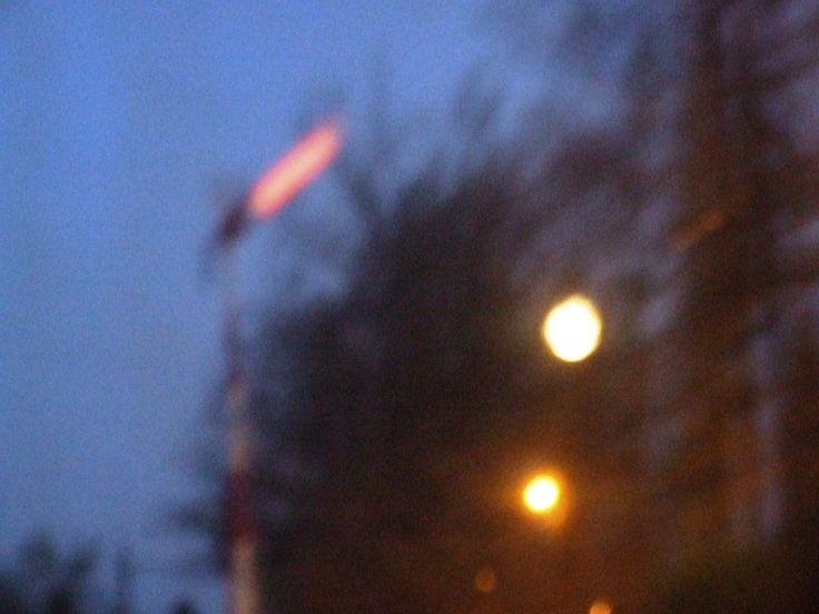 Entry signal, moon and the lamp in an abstract (railway station Mníšek pod Brdy)