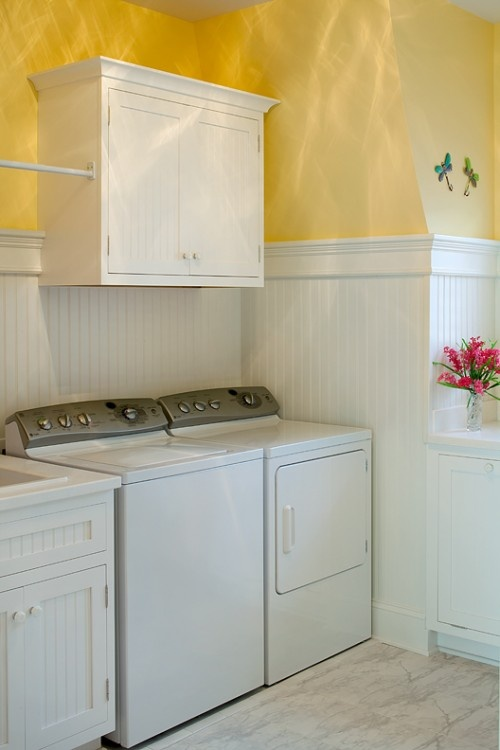 Yellow + Waincoating for your Laundry  LOVE THIS Love the bar for hanging clothes too!