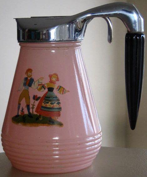 Vintage pink syrup pitcher with original decal and Bakelite handle, via Malcolm Hudson on Flickr.