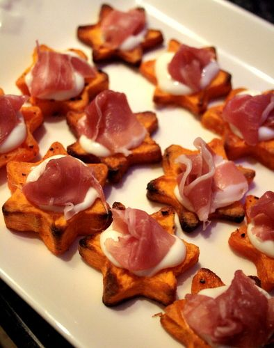 Sweet Potato Stackers- Cut sweet potatoes into 1cm discs,  toss with oil and some seasoning on a baking sheet. Roast 20-30 mins at gas 6 until golden and crisp on the outside, then leave to cool. To serve, mix mayonnaise with lemon juice. Pile a scrunched up piece of prosciutto on each star, top with a blob of mayo. | Butcher, Baker