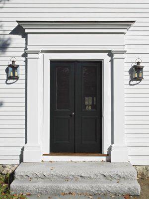 Black front door, front entry surround and double door.