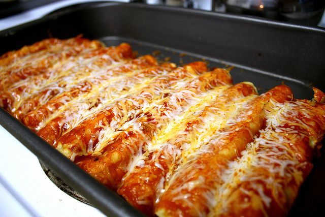 Easy Cheesy Chicken Enchiladas Recipe: perfect for Cinco De Mayo or any time! This one is so easy and always a crowd pleaser!